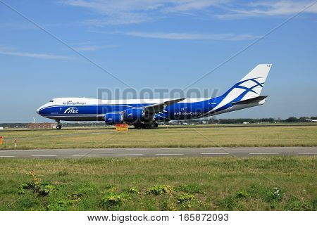 Amsterdam The Netherlands - August 7 2015: VQ-BGZ AirBridgeCargo Boeing 747-8F takes off from Polderbaan Runway.