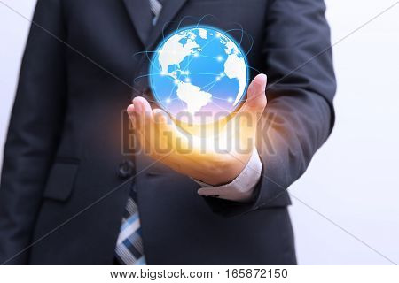 Global connection with digital planet in hand and orange light Future technologies concept