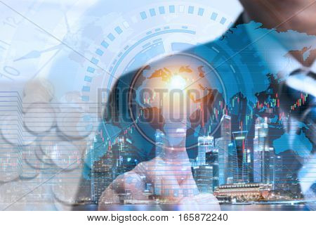 Financial trading stock concept with businessman touching global network and data exchange to check worldwide market stock over cityscape night view