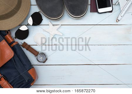Top view of traveler accessories on vintage wooden table with copy space Essential vacation items Travel concept background