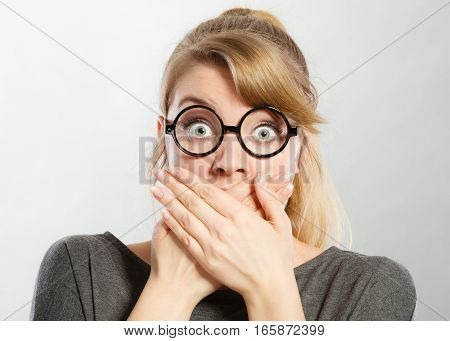 Girl Holding Her Mouth.