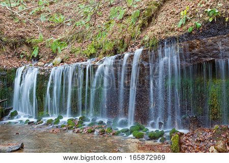 Shiraito Waterfall in autumn season is located in the forests north of downtown Karuizawa Japan