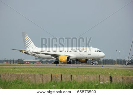 Amsterdam The Netherlands - August 10 2015: EC-KDX Vueling Airbus A320-200 taxing on the Polderbaan runway to the main terminal of Amsterdam Schiphol Airport