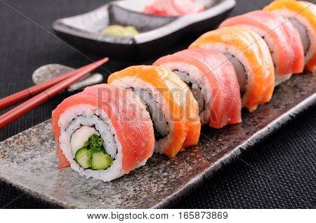 Salmon and tuna sushi roll on a saucer