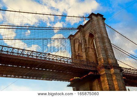 Clouds above Brooklyn Bridge wide angle view - New York Brooklyn Bridge pylon