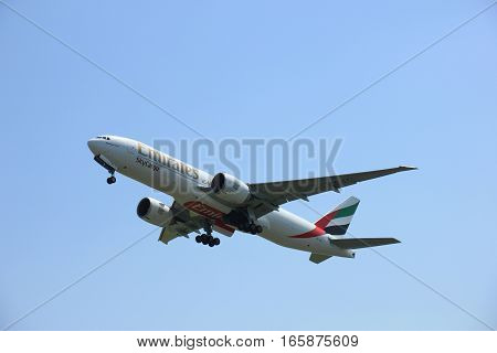 Amsterdam The Netherlands - June 12 2015: A6-EFL Emirates Boeing 777F takes off at Amsterdam Airport Schiphol Polderbaan runway. Emirates SkyCargo is a cargo airline based in Dubai United Arab Emirates. It is the air freight division of Emirates.
