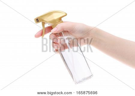 Hand holding spray perfume plastic bottle on white background