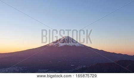 Top of Mt. Fuji and sunrise sky in autumn season