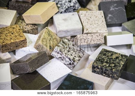A floor tiles made of durable natural stone granite and marble. Samples of stone for floor tiles, wall tiles, kitchen countertops, backsplash, bathroom vanity and table surface.