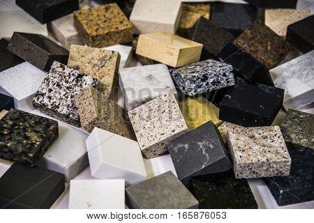 Granite worktops color samples. Natural stone square colorful work tops