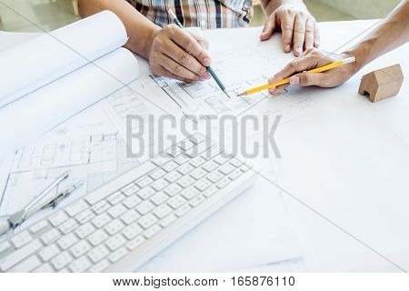 Team of architects people in group on construciton site check documents and business workflow.