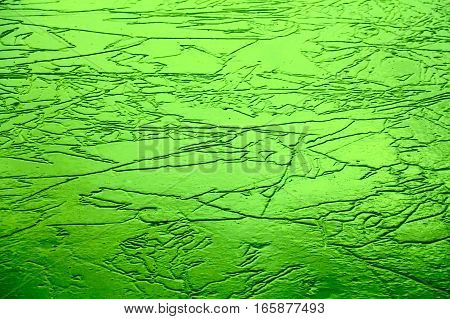 Ice on a lake that has melted cracked and frozen again amazing texture background image.