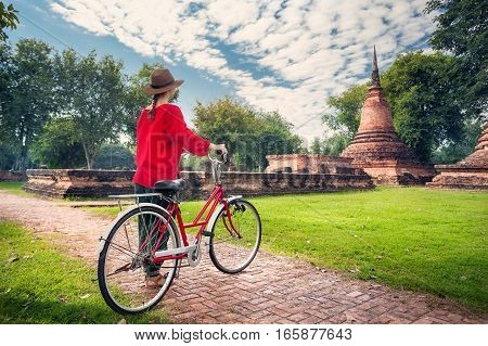Woman With Bicycle Near Buddhist Ruins
