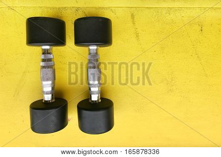 dumbbells in the gym for weight lifting exercise
