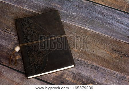 Classic Leather Bound Journal Book on a Old Barn Board Floor