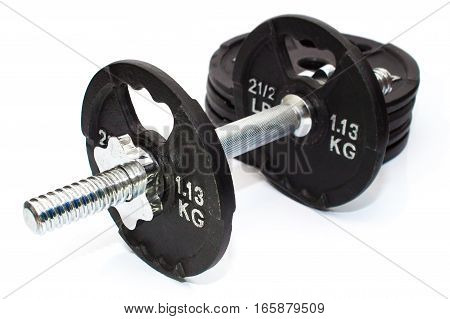 Dumbbell Weights With Spare Weights In Background