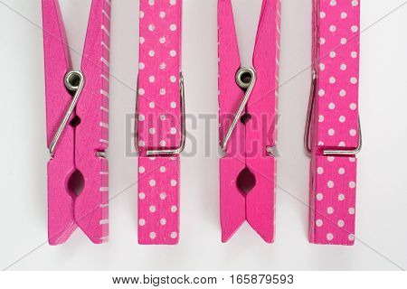 Four Pink Clothes Pins With Fun Patterns Two Flipped Top View