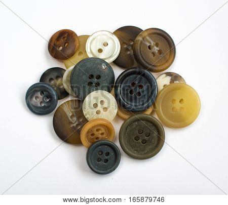 Pile of Assorted Colorful Buttons Isolated on White