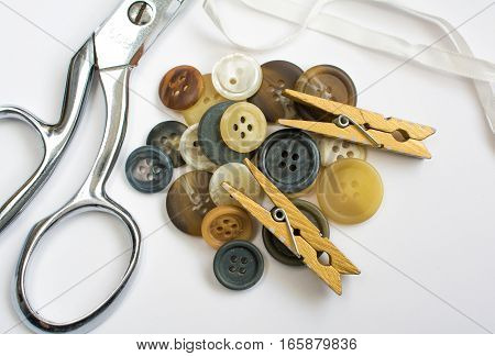 Pile Of Buttons With Sewing Materials Isolated On White