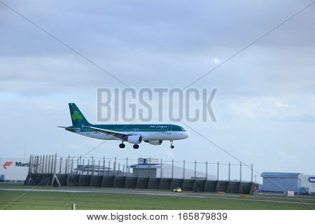 Schiphol Amsterdam The Netherlands march 31 2015: EI-DEE Aer Lingus Airbus A320-200 approaching on runway 09/27 Buitenveldert