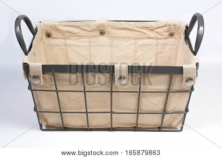 Metal Wire Basket Cloth Interior And Handles Side Angled View