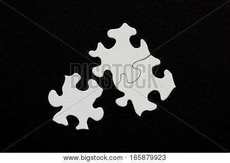 Three Blank Puzzle Pieces On Black Background One Unlinked