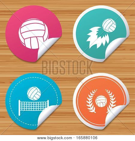 Round stickers or website banners. Volleyball and net icons. Winner award laurel wreath symbols. Fireball and beach sport symbol. Circle badges with bended corner. Vector