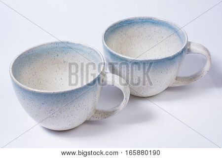 Two Speckled Blue Mugs Isolated on White
