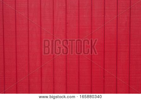 Worn rustic red barn board paneling texture