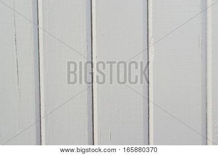 Vintage white wood paneling with cracking texture