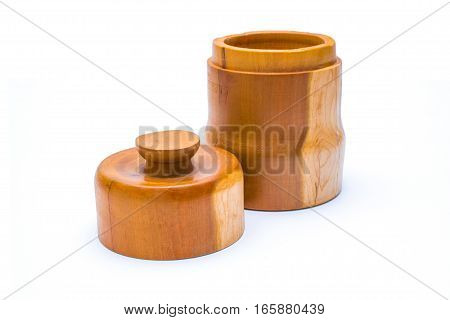 Wooden jar with lid off to the side in front