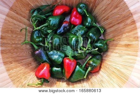 Green and Red Poblano Peppers in a Bamboo Bowl