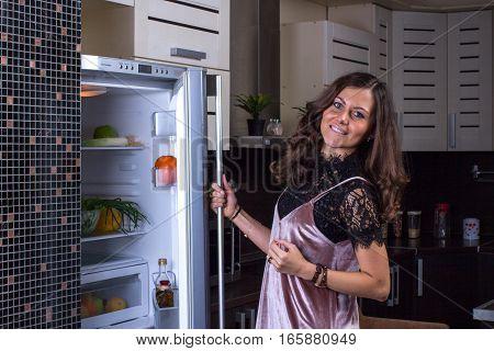 Happy Woman Opening Fridge At Night time