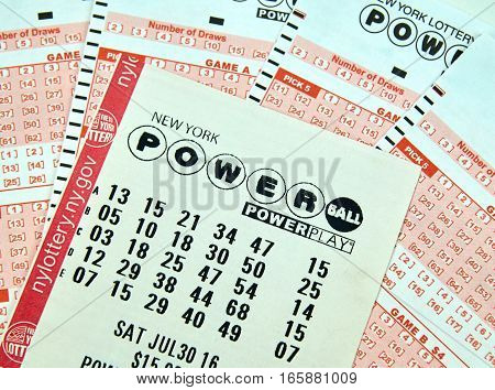 MONTREAL CANADA - DECEMBER 23 2016 : Powerball New York lottery tickets. Powerball is an American lottery game offered by 44 states the District of Columbia Puerto Rico and the US Virgin Islands.