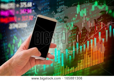 Hand hold smart phone on stock market and financial data background for your design. Stock market graph. Stock market indicator. Stock market financial graph. Stock market analysis. Financial statistic analysis. Financial investment graph.
