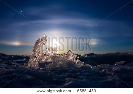 Lunar Halo Shining Through The Transparent Ice Ridge, Olkhon Island, Lake Baikal