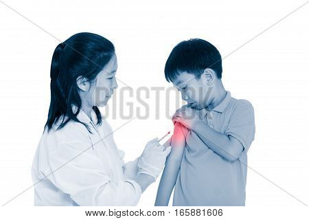 Doctor vaccinating boy's arm. Asian illness boy worry about vaccine syringe, on white background. Human health care and medical concept. Photo with color increase blue skin and red spot.