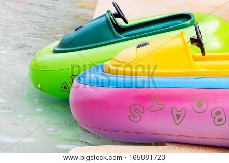 colorful rubber boats in pond in water park
