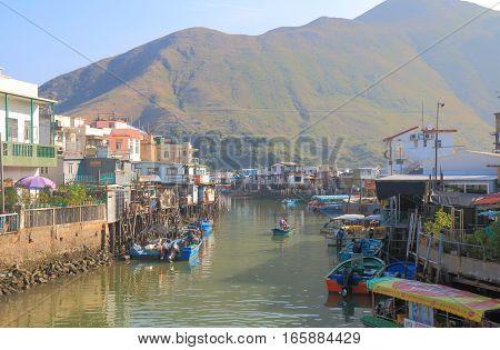 HONG KONG - NOVEMBER 7, 2016: Unidentified people fish in Tai O fisherman's village.