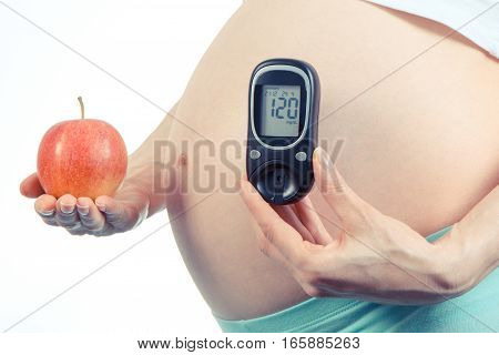 Vintage Photo, Pregnant Woman With Glucometer And Apple, Diabetes And Healthy Nutrition During Pregn