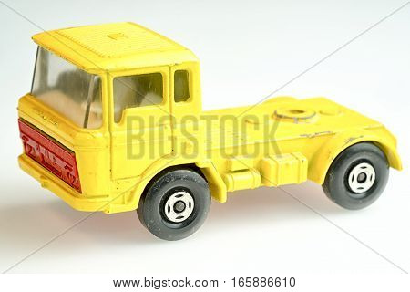 Moscow Russia - January 19 2017: Yellow toy DAF lorry on a white background.