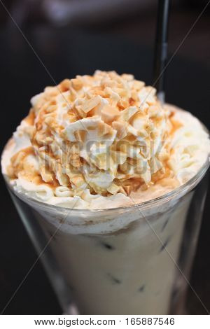 Closeup nutty white chocolate drink in the glass