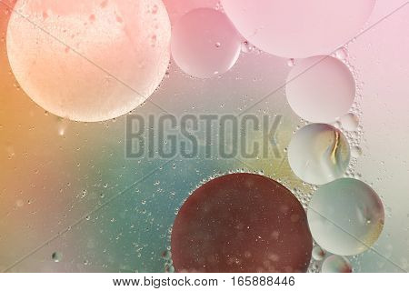 Abstract colorful backdrop with oil drops on glass
