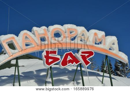 BUKOVEL, UKRAINE - December 2, 2016: Panorama Bar sign with icicles . Bukovel is the most popular ski resort in Ukraine.