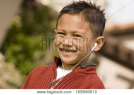 Portrait of an Asian little boy smiling.