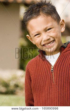 Portrait of an Asian little boy smiling.