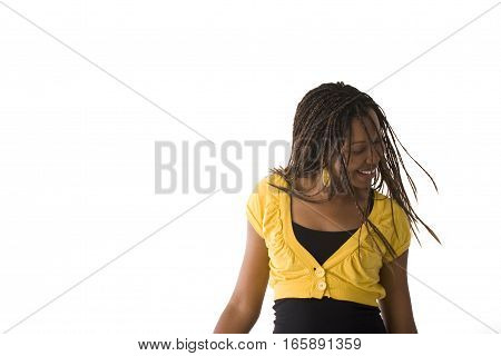 African American woman laughing with her hair flying.