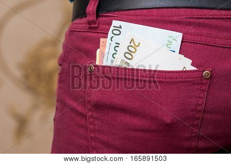 different  Euro notes in red jeans pocket