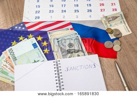russia sanctions - note, pen, flag and money