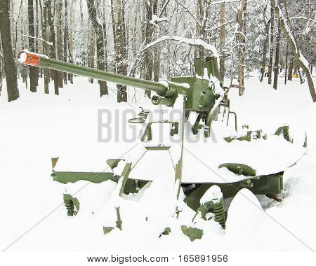 anti-aircraft gun in the park in winter